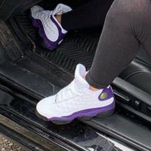 Purple and white Jordan 13s